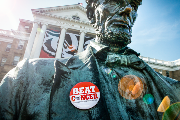 Beat Cancer button on Abe Lincoln statue on Bascom Hill